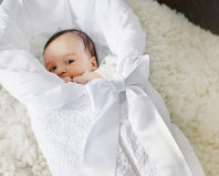 Новорожденный в белоснежном конверте